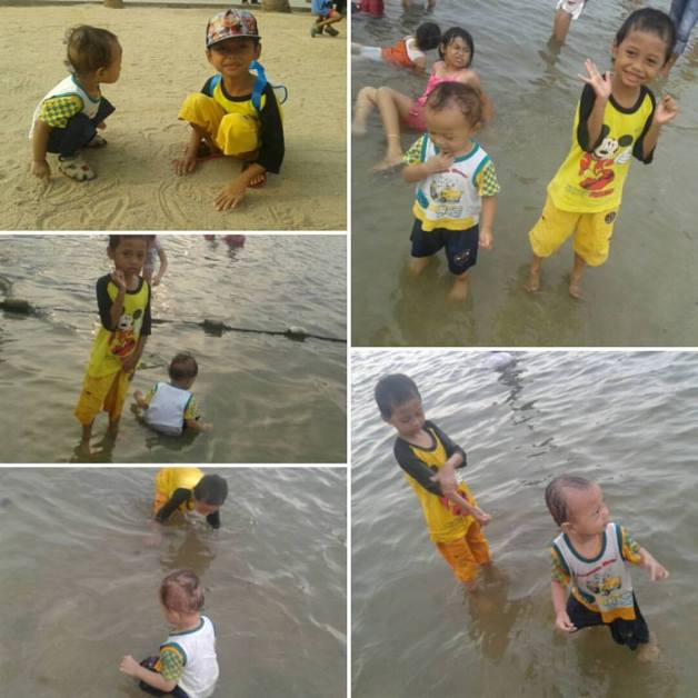 Janji awalnya main pasir doang, lama-lama pingin ngerendem kaki, akhirnya nyebur juga dan basah kuyup :D